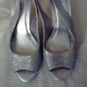 Silver high heal sling back open toed shoes